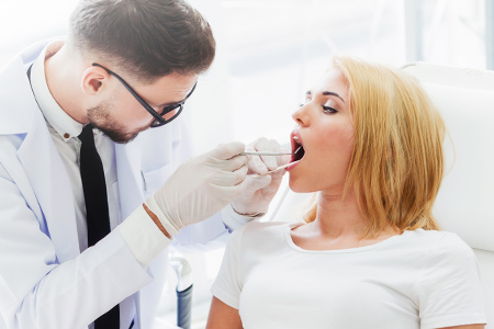 Oral surgeon with patient