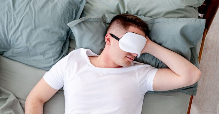 Young man after wisdom tooth removal trying to fall asleep.